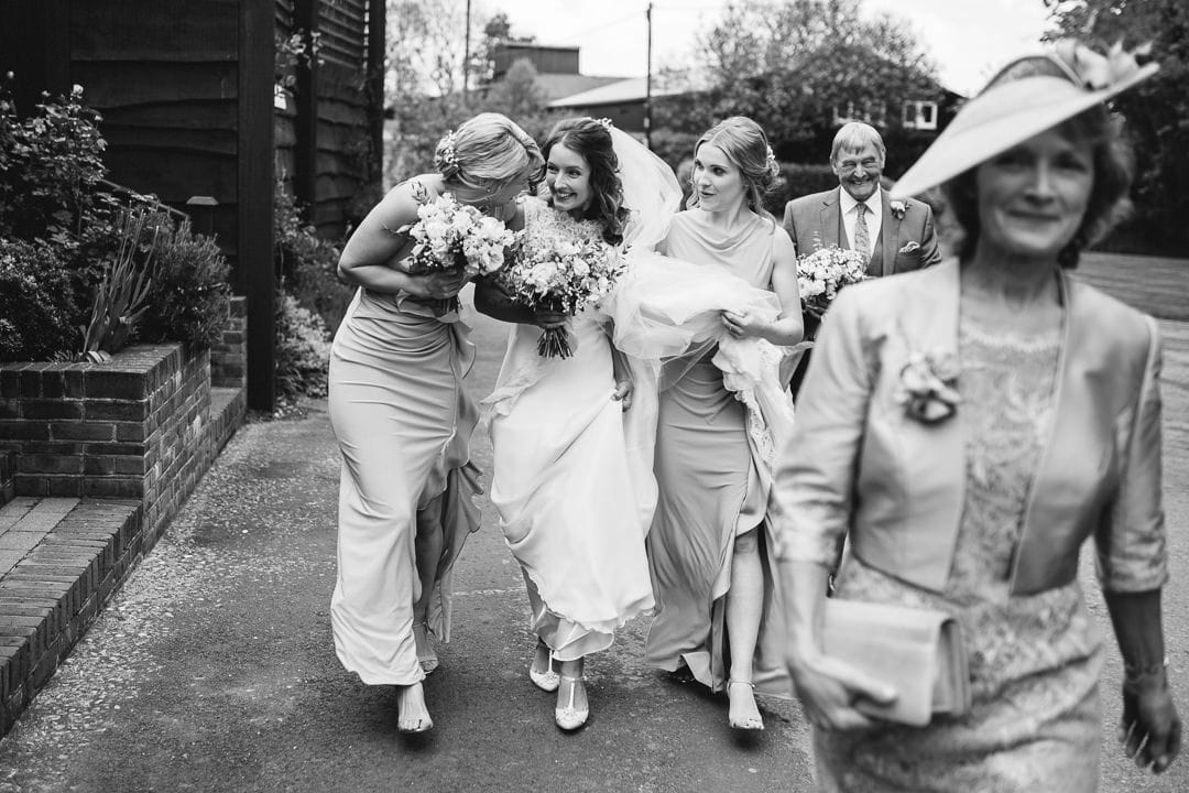 bride and bridesmaid on the way to ceremony