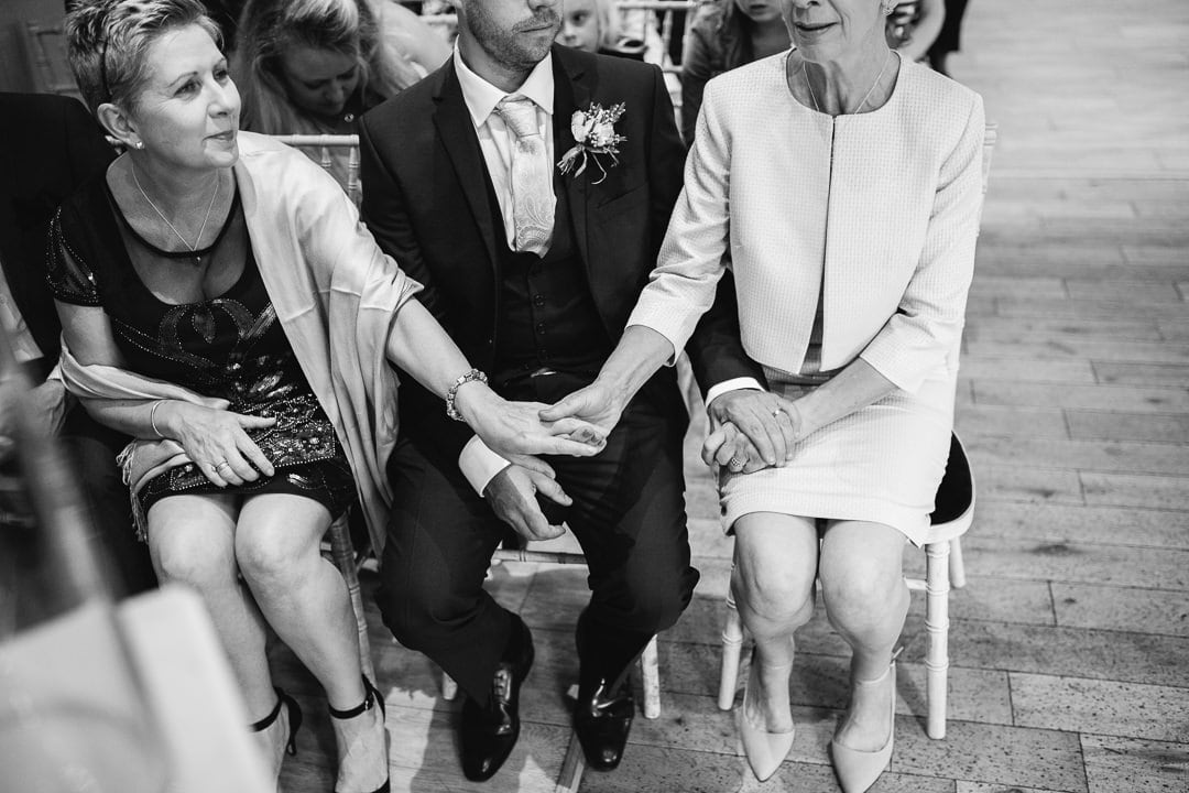 holding hands at wedding