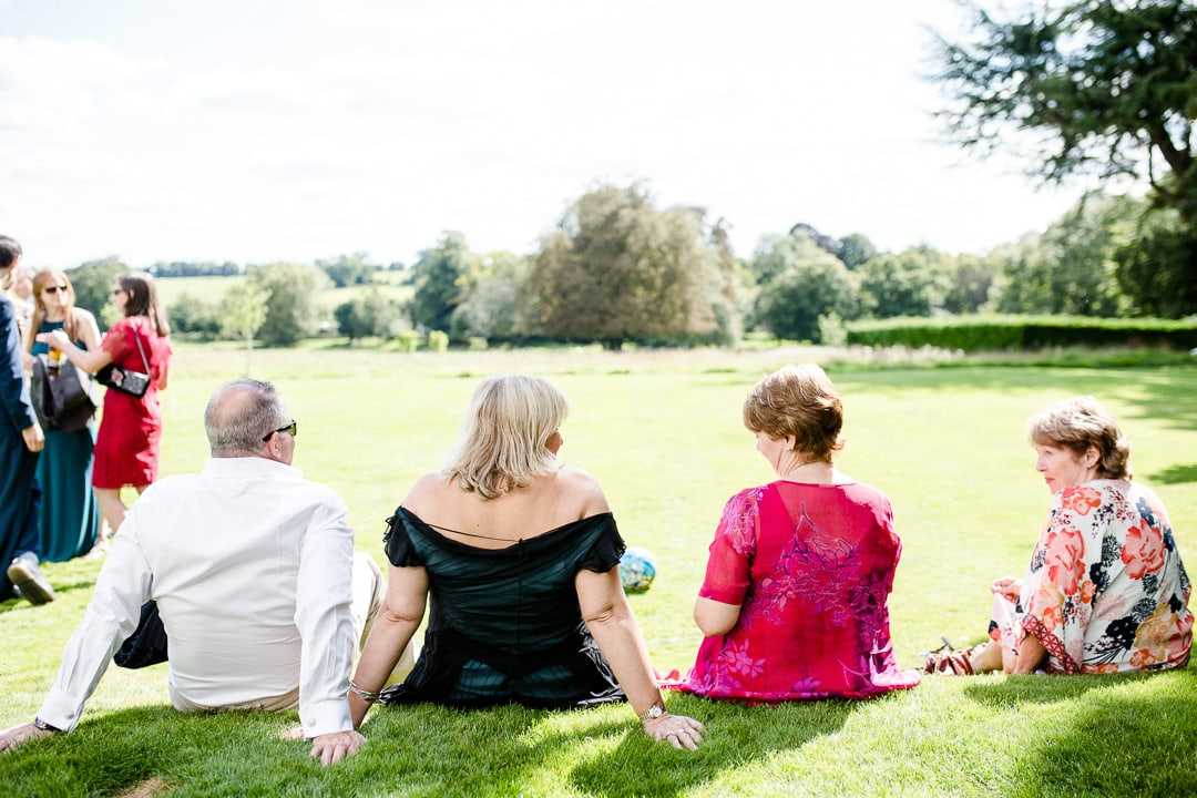 guests relaxing on the grass at wedding reception