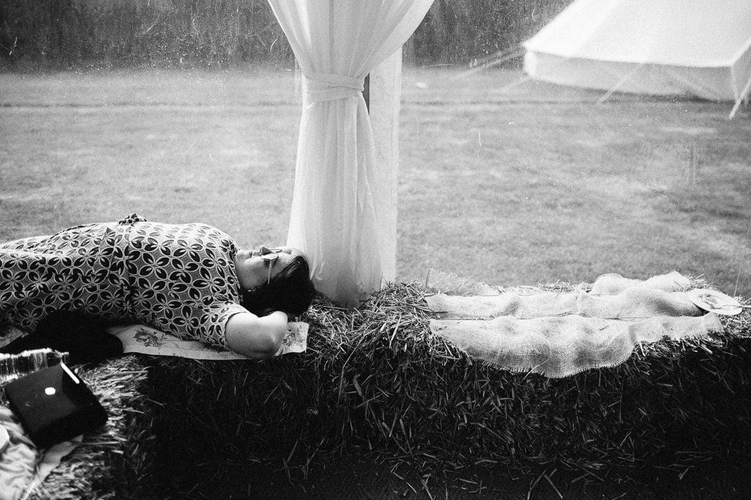 guest asleep on hay bail