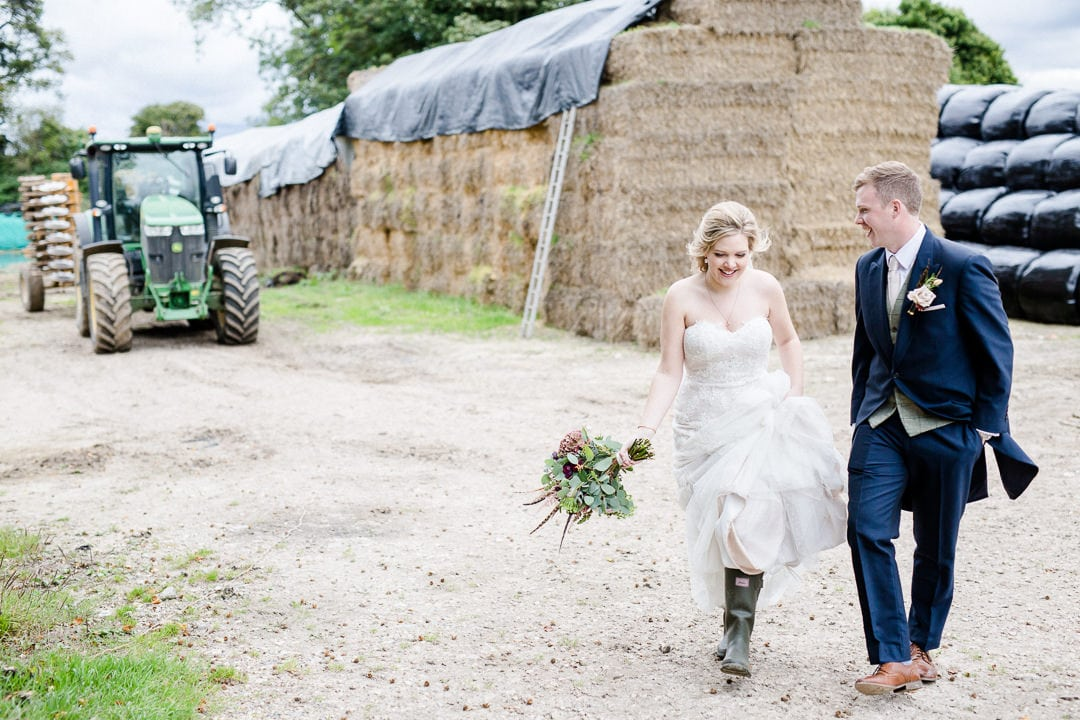 bride and groom on farm with tractor