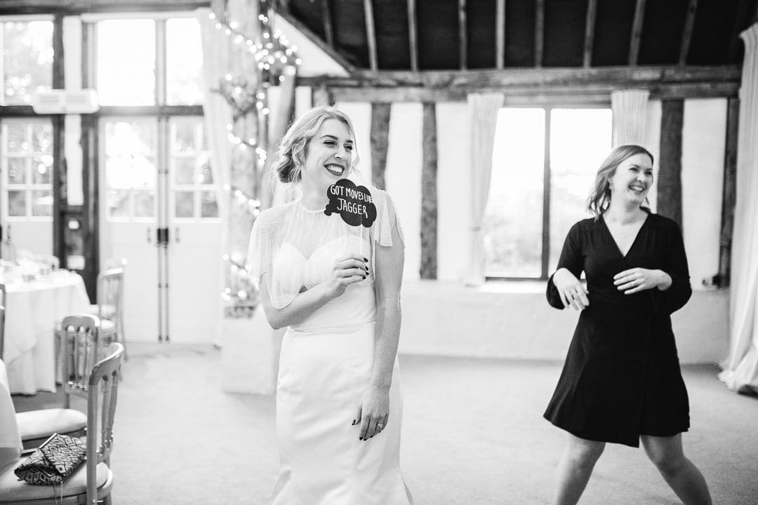 bride holding moves like jagger sign