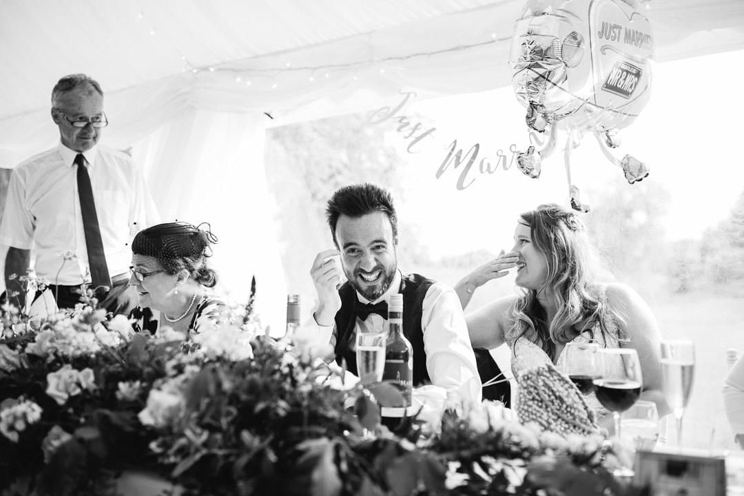 wedding speeches, groom laughing