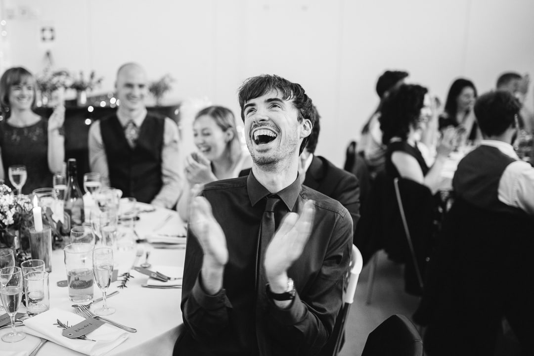 guest clapping during speeches