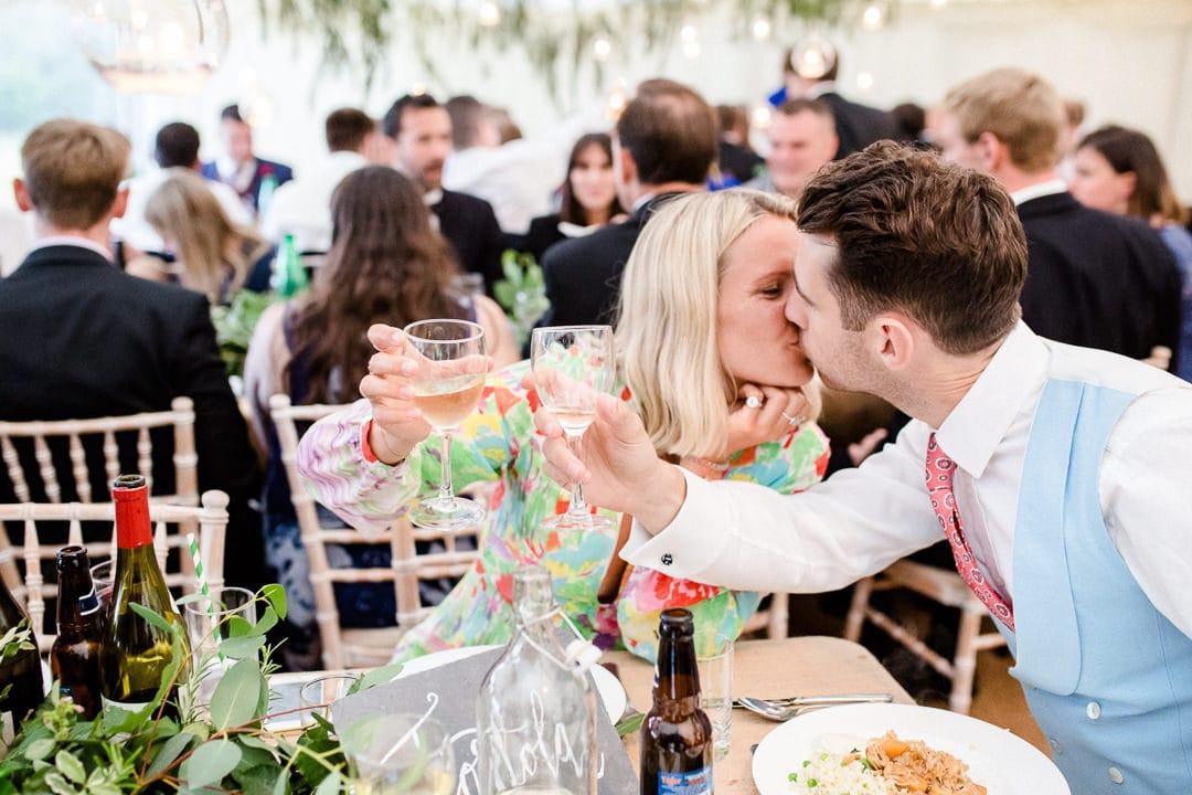 couple kissing at wedding
