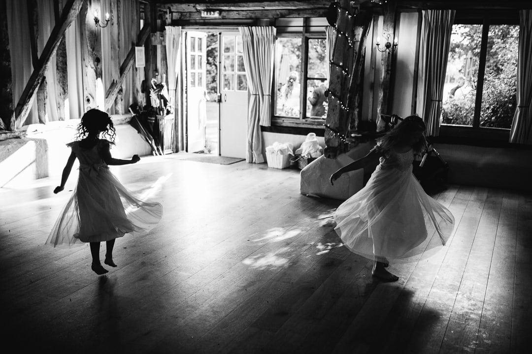 flower girls dancing at wedding