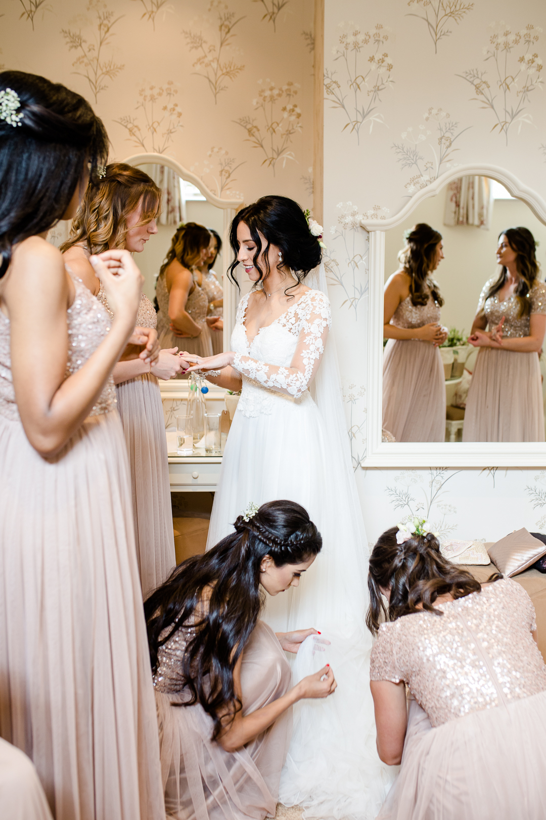 Bride and bridesmaids getting ready for wedding at Clock Barn Hampshire
