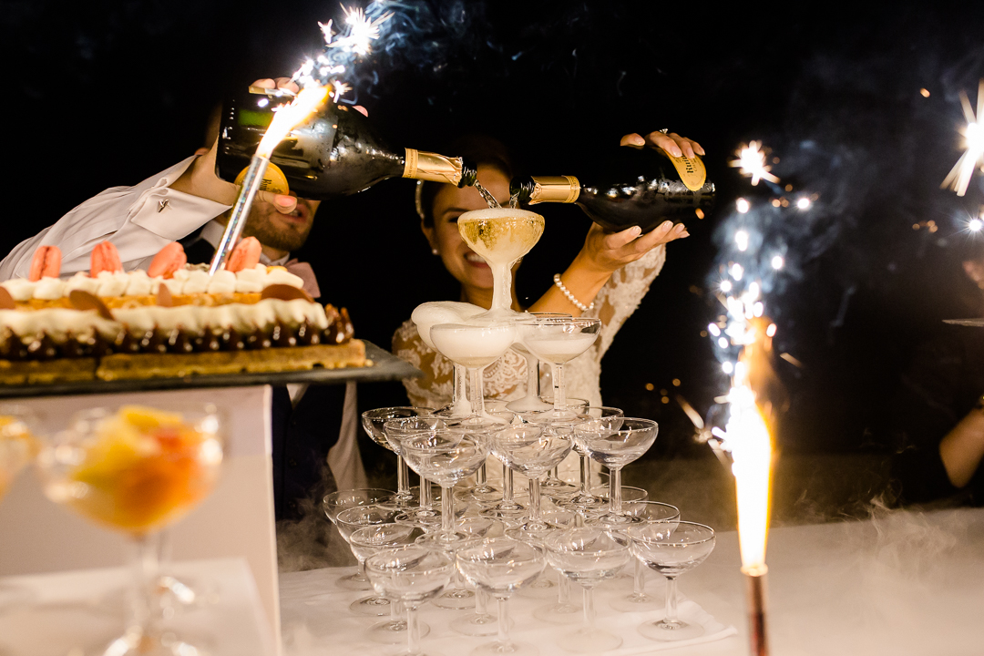 bride and groom pouring champagne cascade image
