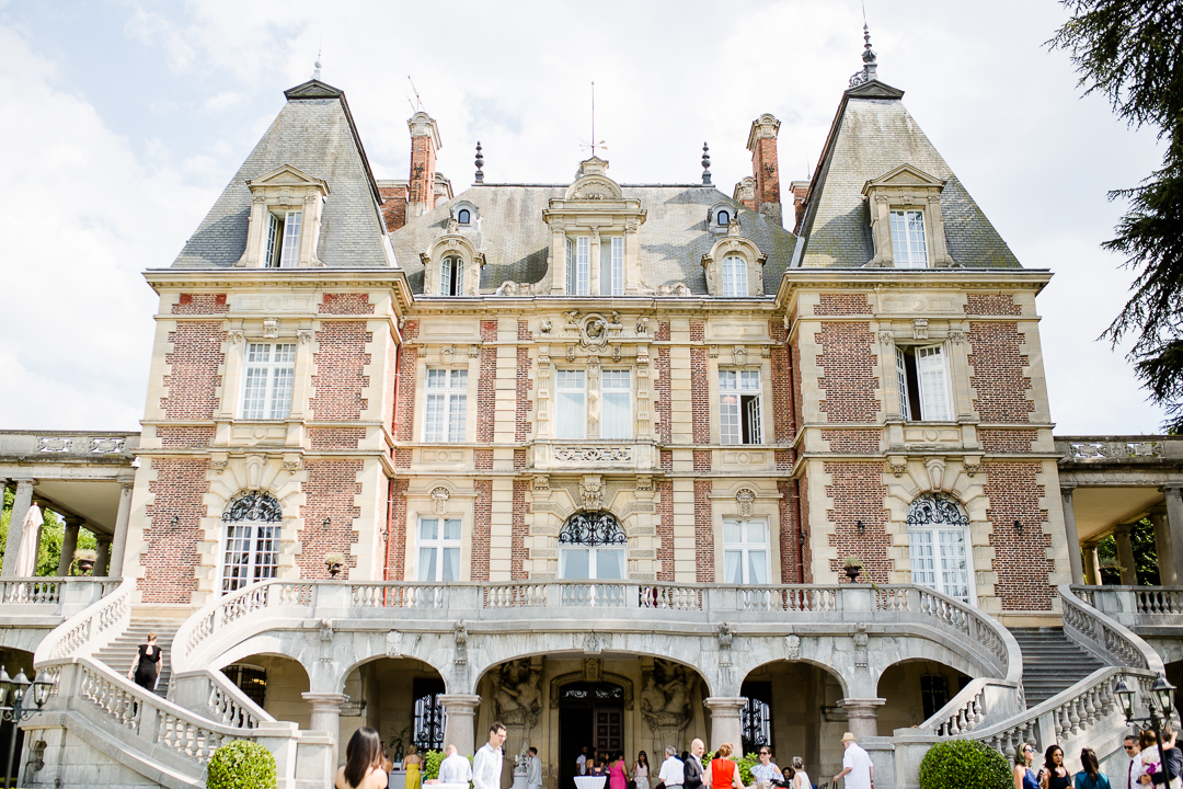 summer wedding drinks reception outside of chateau bouffemont paris france image