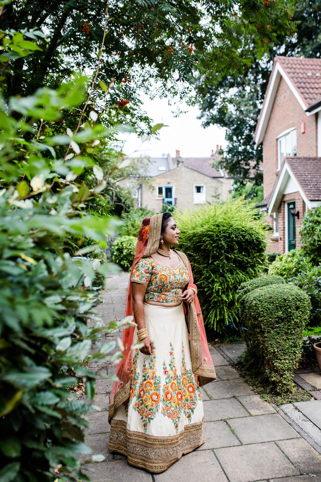 British Asian bride in sari for her wedding