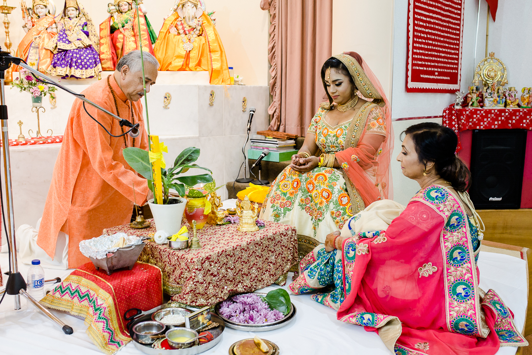 bride is blessed before her hindu wedding ceremony