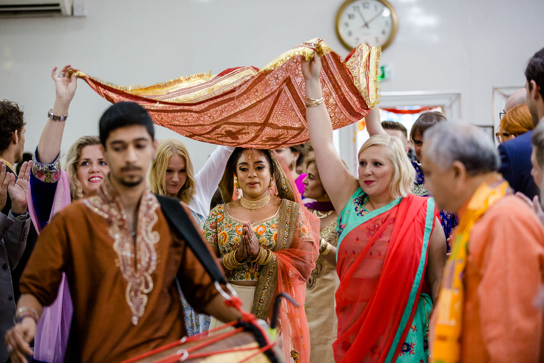 bride enters the temple for her hindu wedding