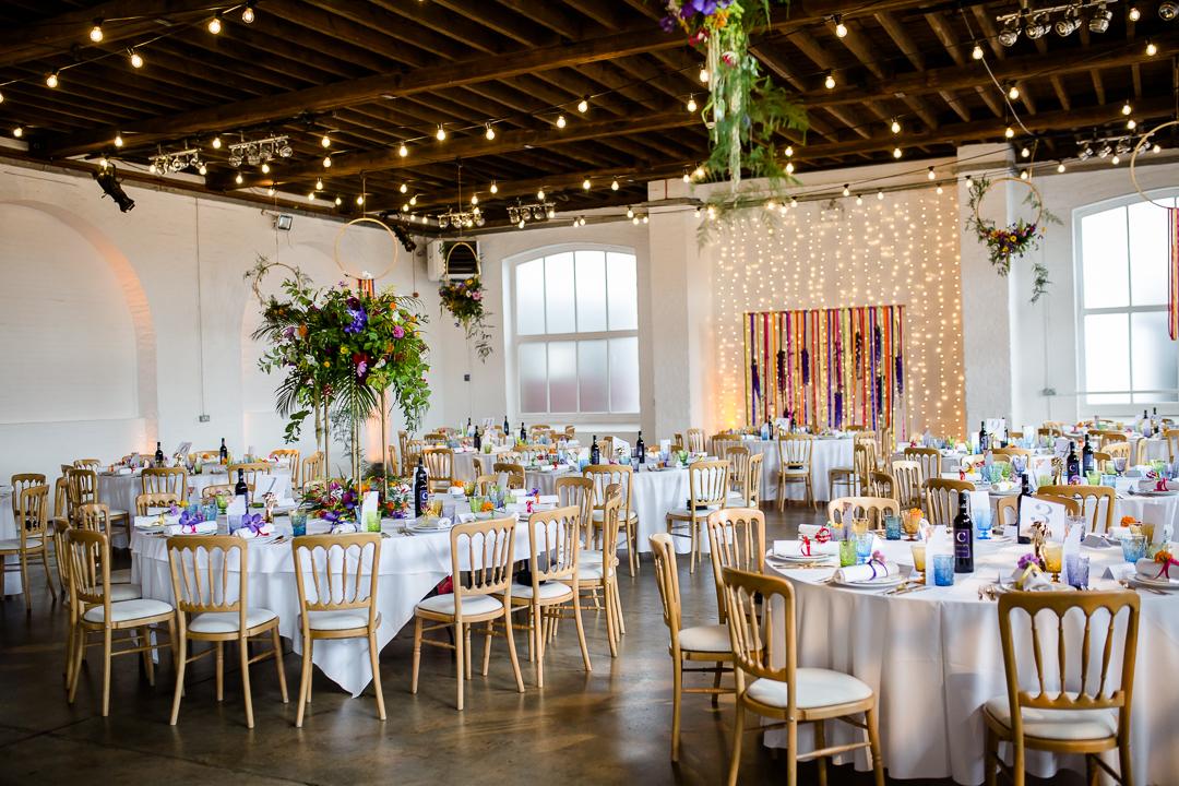 Interior of Trinity Bouy Wharf London warehouse wedding venue set for a wedding
