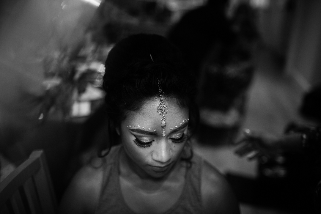 black and white photograph of a bride wearing a tikka for her hindu wedding