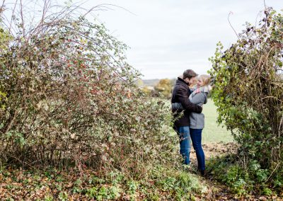 winter engagement photoshoot in english hedgerow