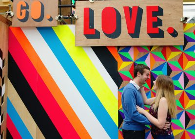 couple engagement photo colourful love background