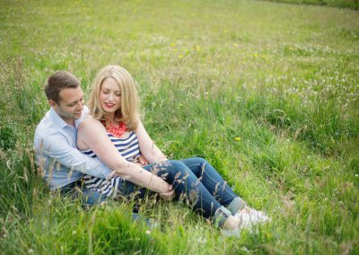 couple in meadow for engagement photo