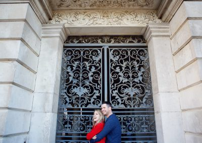 couple hugging in old doorway engagement photograph