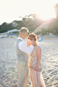 bride and groom on beach in sun