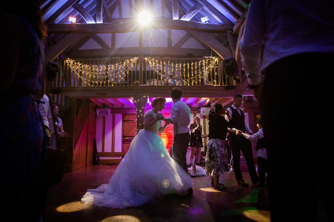 bride and groom dancing at cain manor
