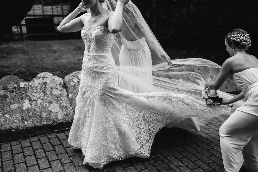 lace wedding dress blowing in the wind, wedding veil, bride