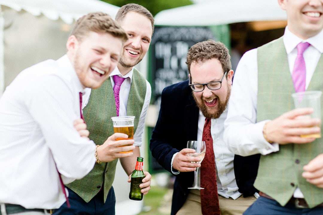 wedding guests laughing