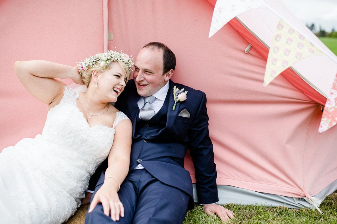 bride and groom with bell tent