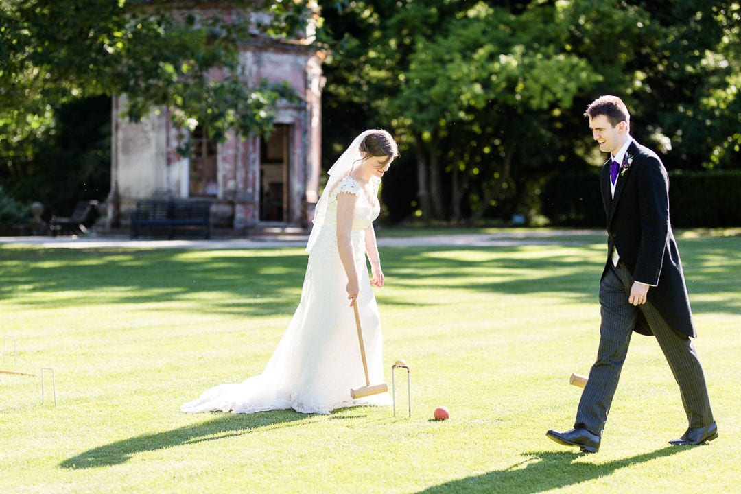 bride and groom playing croquet at Larmer Tree Gardens