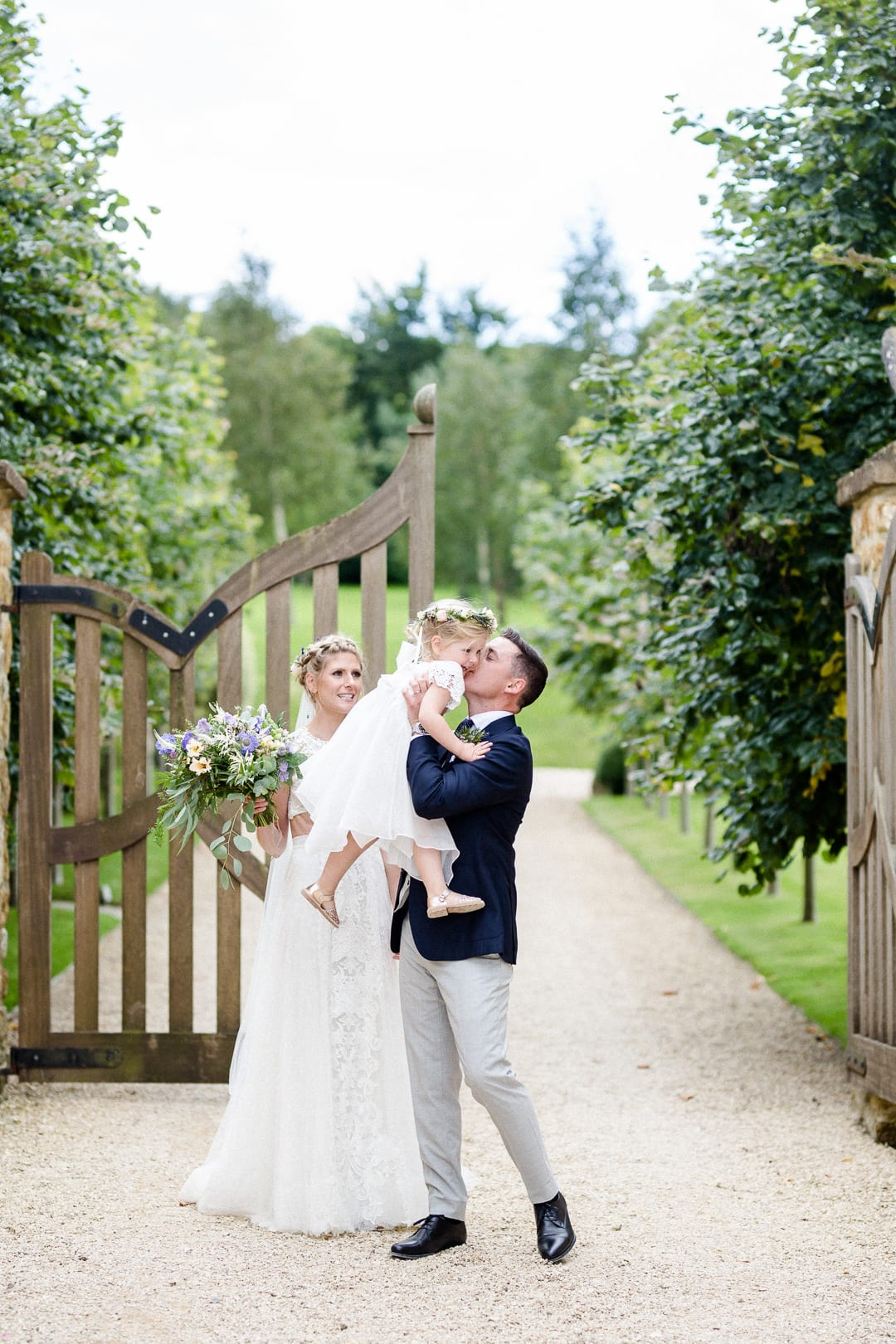 bride, groom and their child at Axnoller