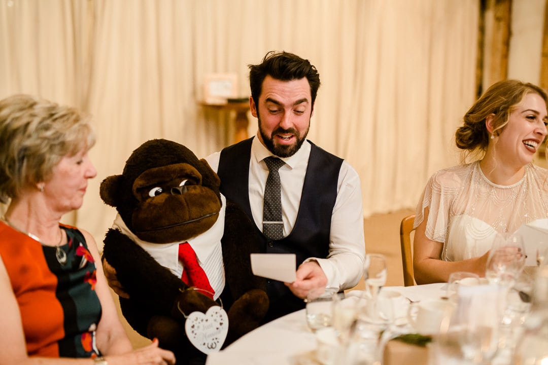 groom with giant chimpanzee toy