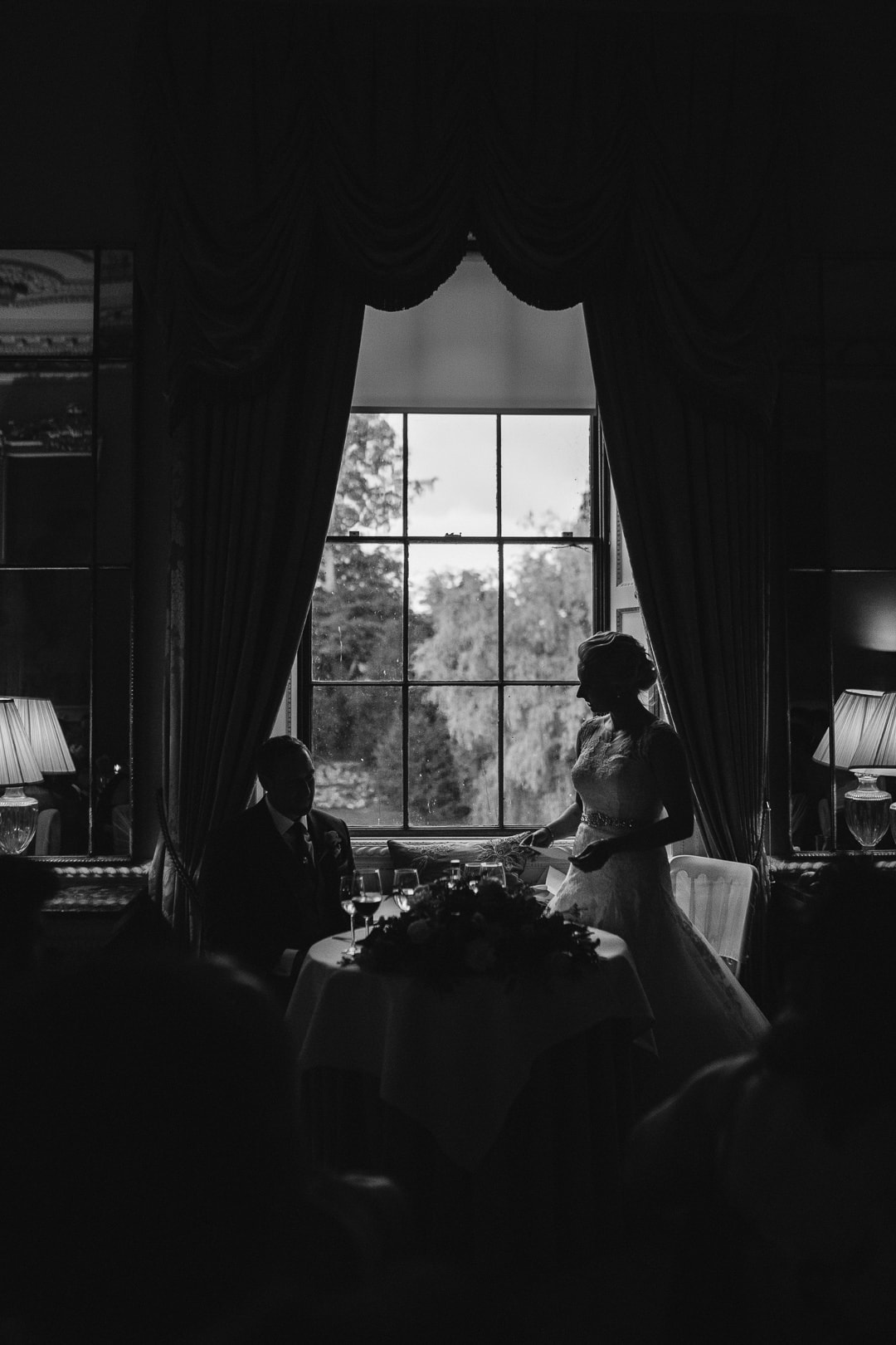 silhouette of bride and groom during speeches