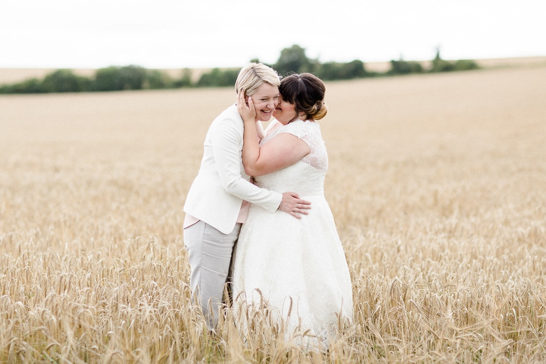 lesbian wedding, two brides, same sex wedding, couple in cornfield