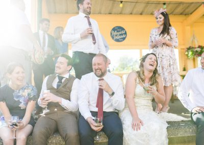 guests laughing at wedding with bride
