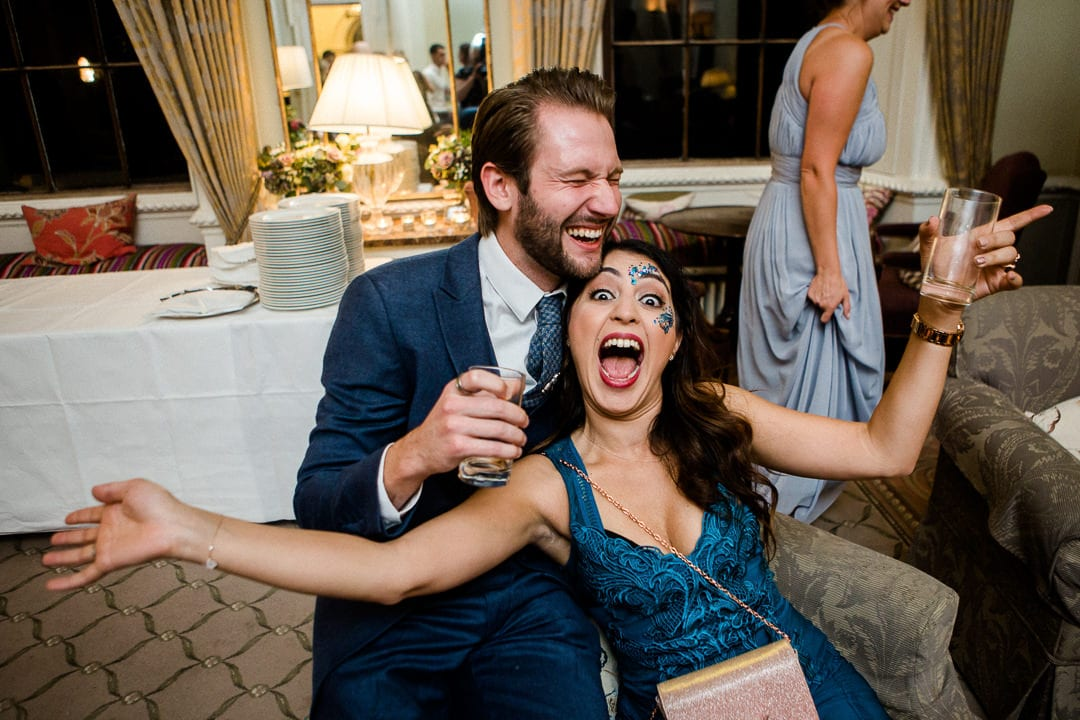 couple laughing at wedding