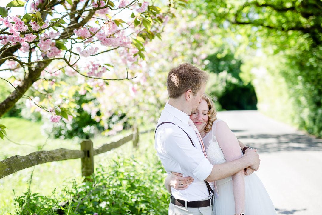 bride and groom having a hug