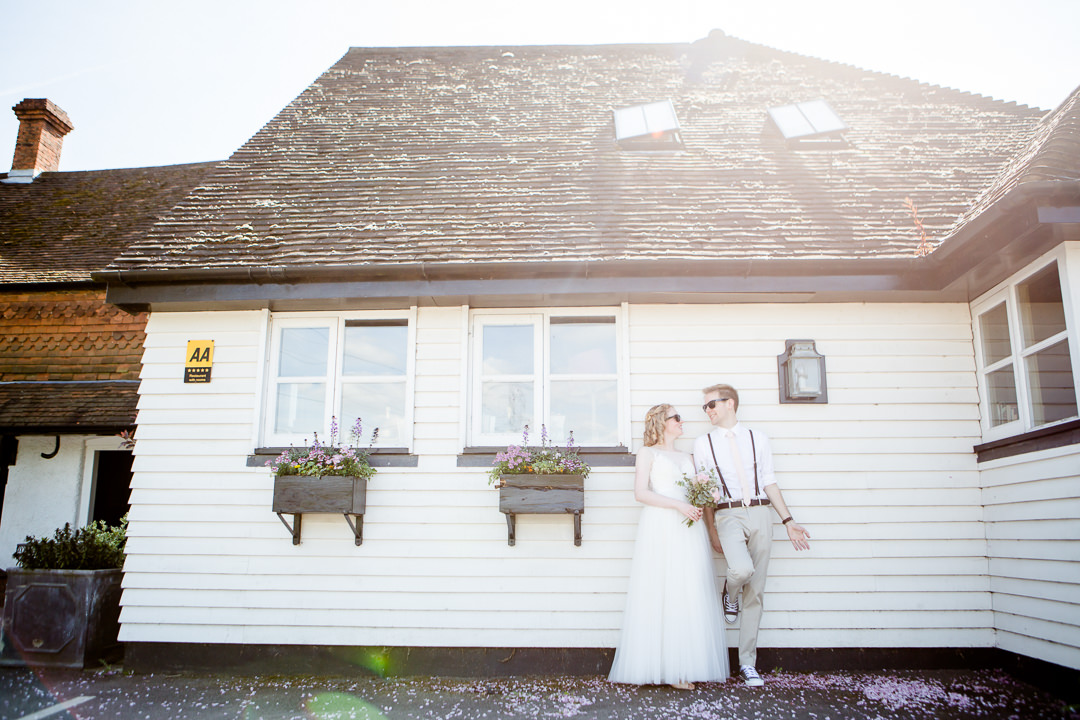 bride and groom outside the anchor inn lower froyle hampshire