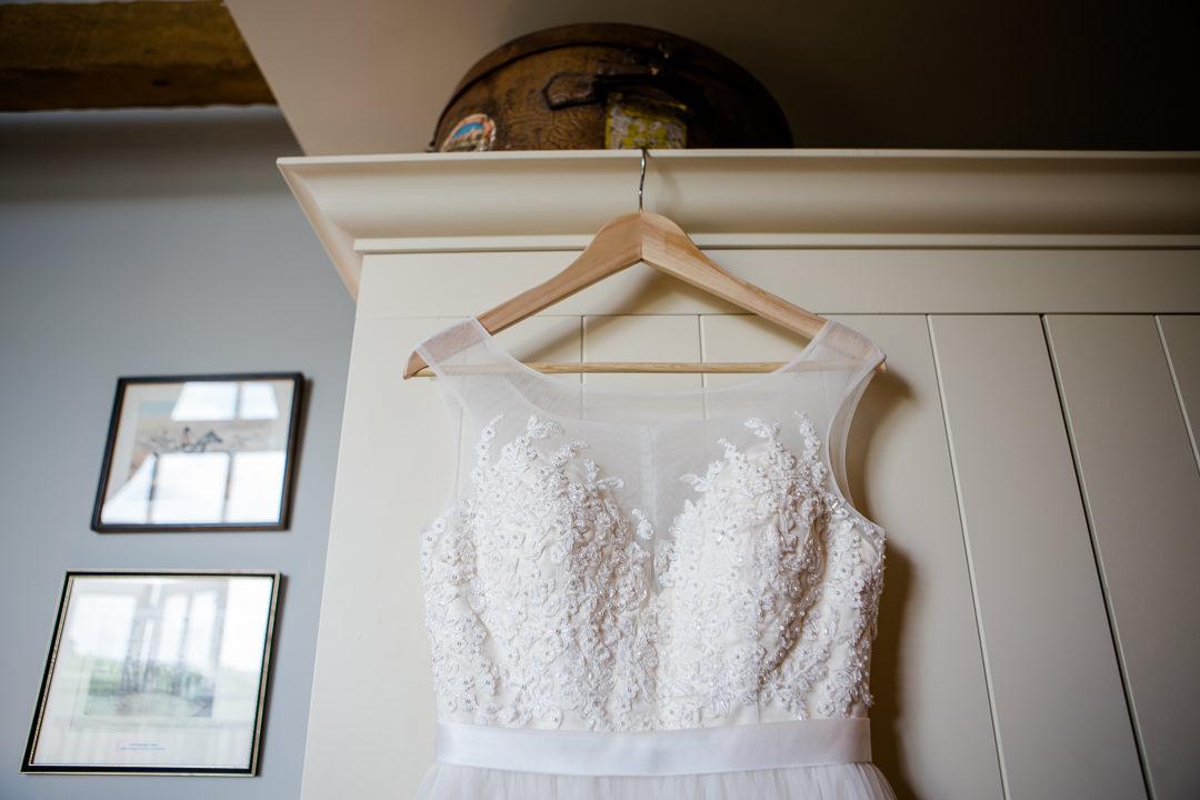 wedding dress hanging from wardrobe