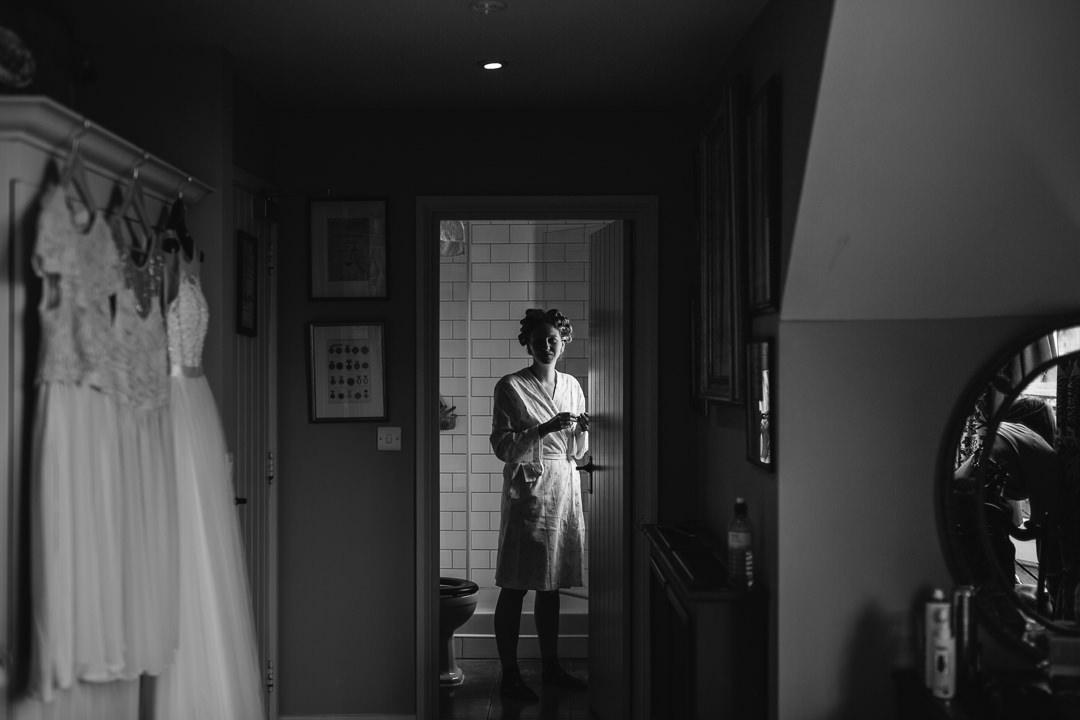 bride in bathroom at The Anchor Inn Lower Froyle