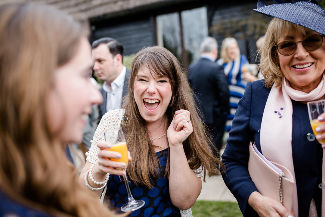 wedding guest laughing at Clock Barn Hampshire
