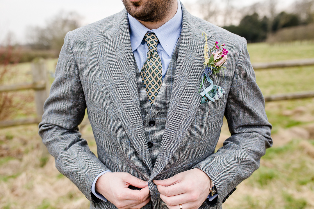groom's three piece suit and tie