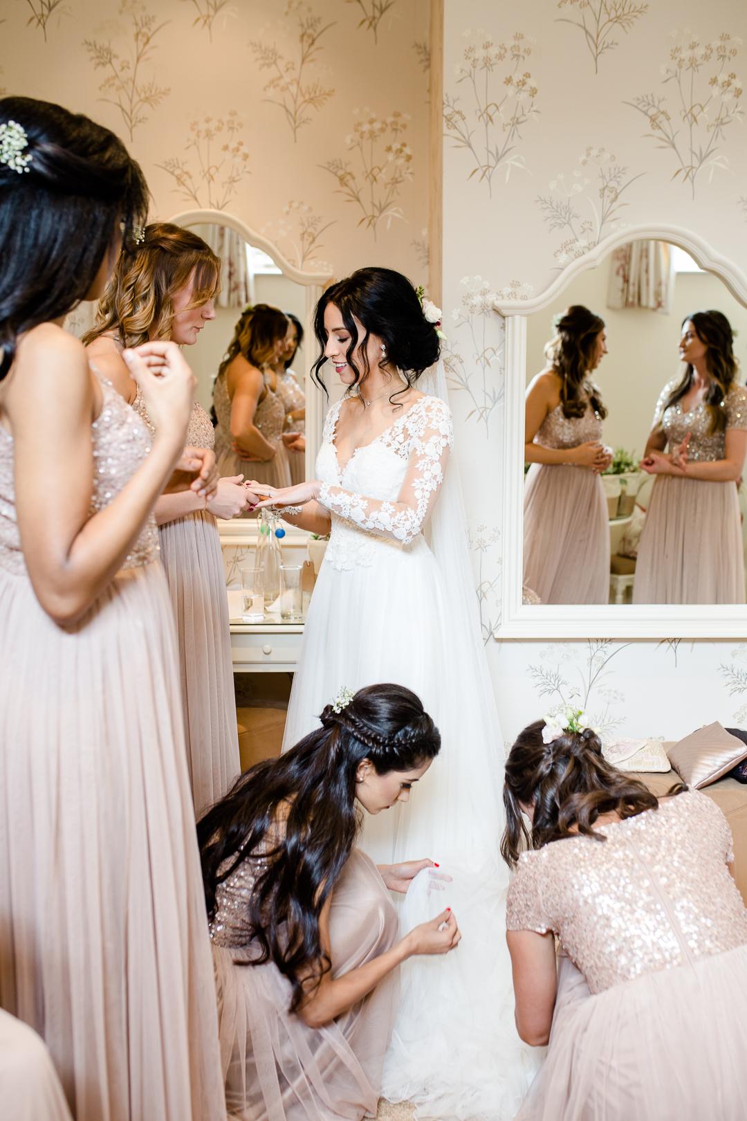 Bride and bridesmaids getting ready for wedding at Clock Barn Hampshire