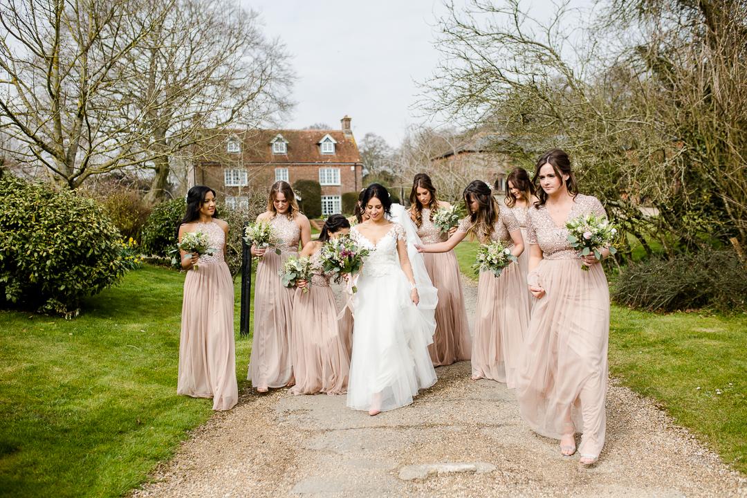 Bride and Bridesmaids walking to wedding at Clock Barn Hampshire