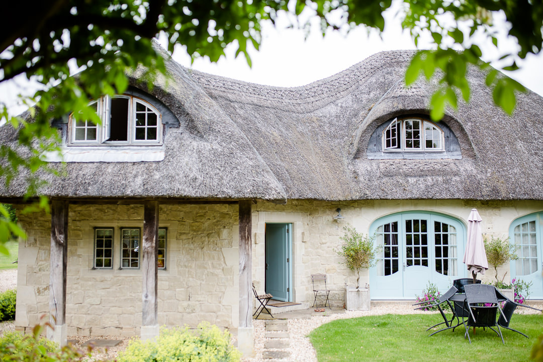 Thatched cottage with duck egg blue doors