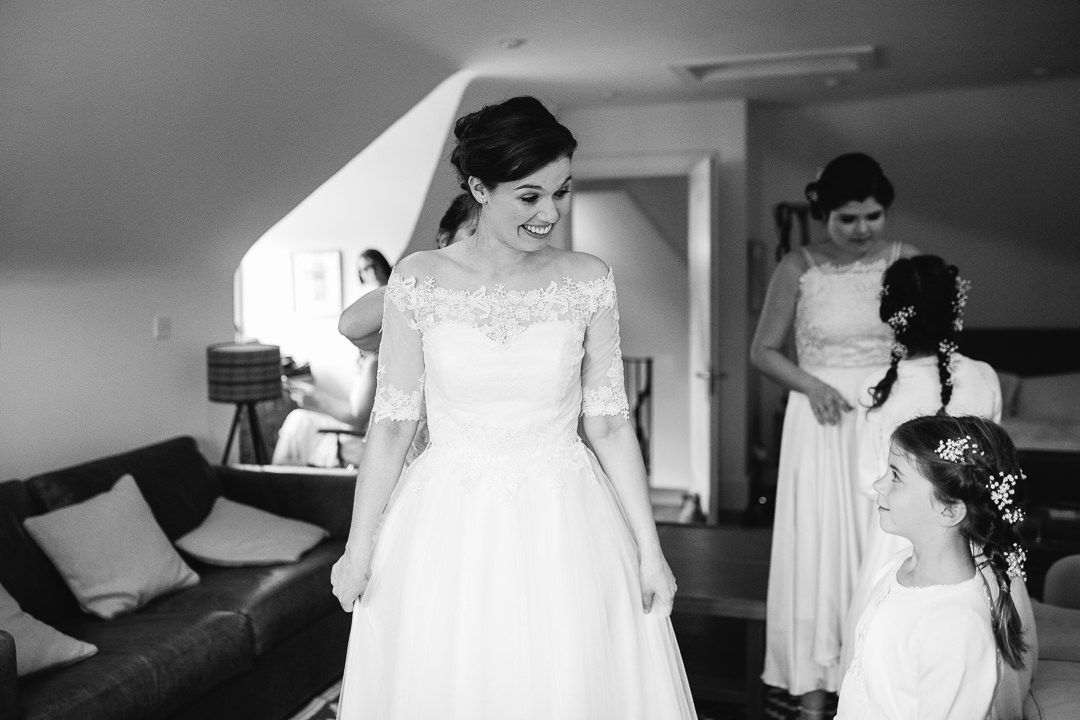 bride and flower girl exchanging excited look photo by Lydia Stamps Photography