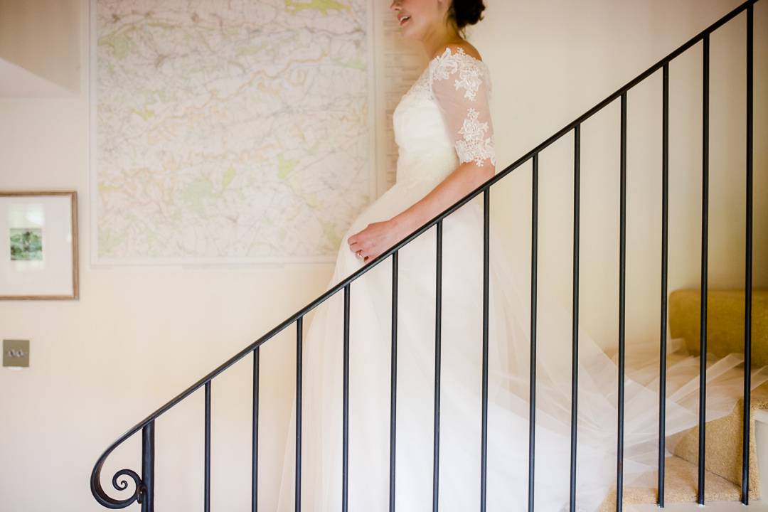 bride coming downstairs photo by Lydia Stamps Photography