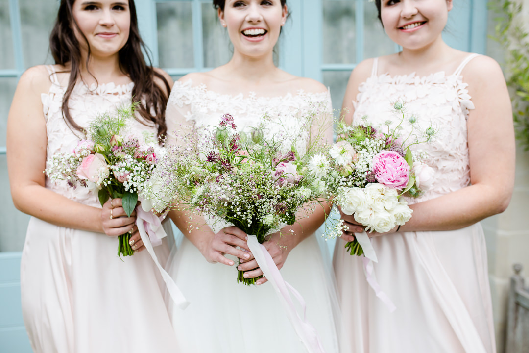 bride and bridesmaid's bouquets photo by Lydia Stamps Photography