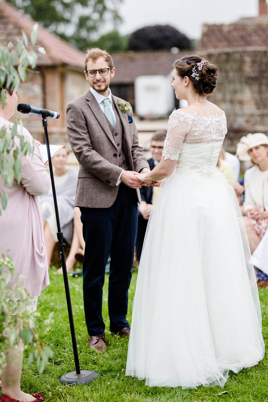 bride and groom during vows in an outdoor wedding ceremony