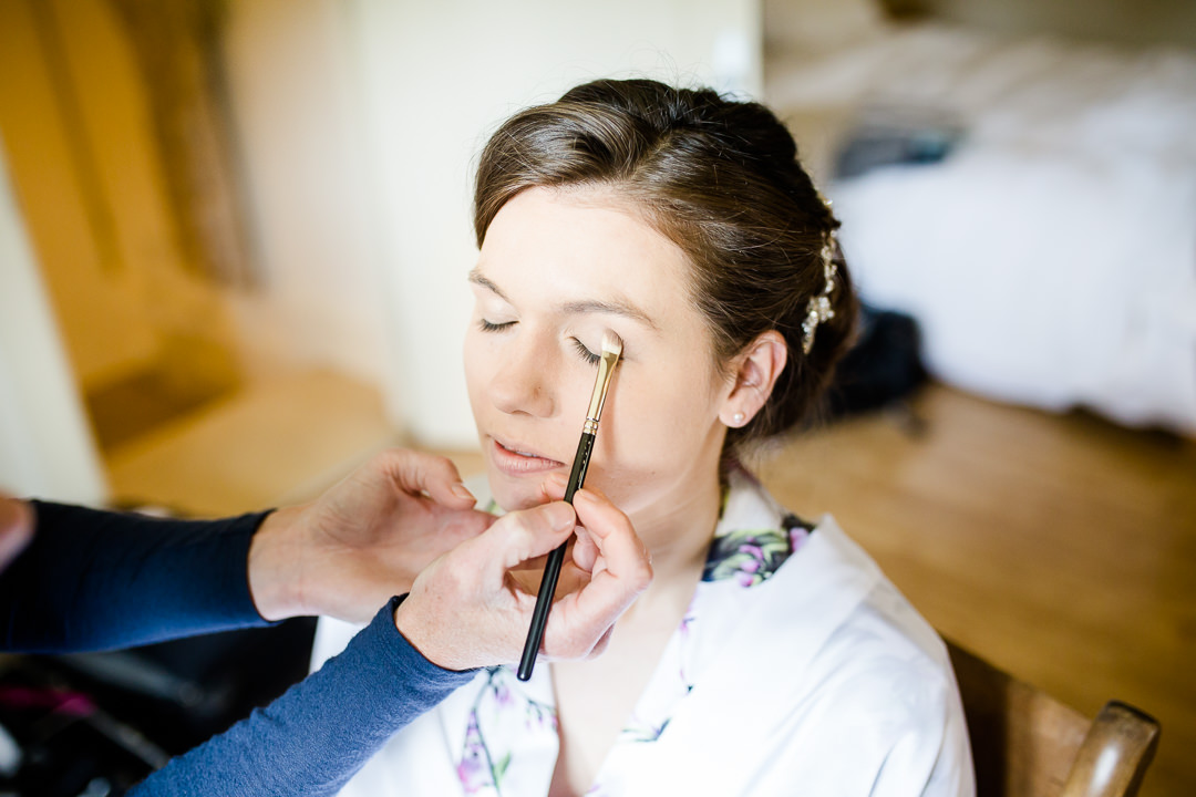 bride having make up applied by Victoria Fergusson