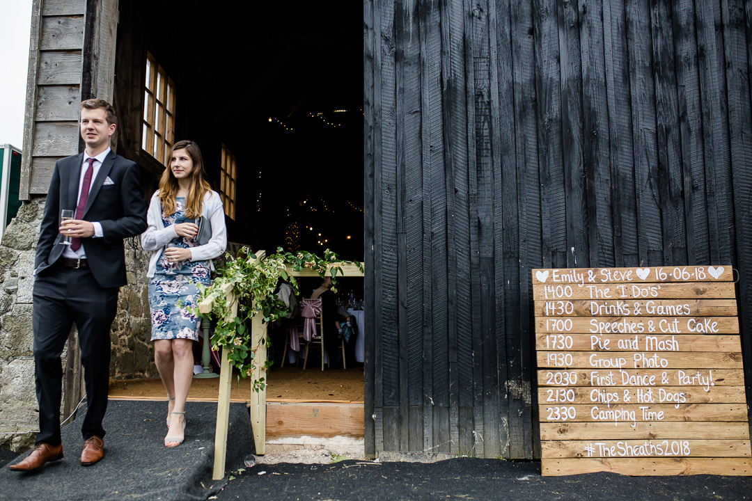 rustic wooden palette sign at barn wedding