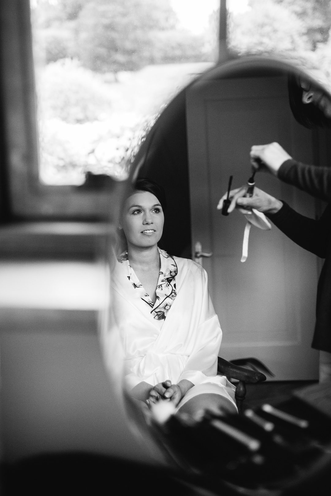 bride's reflection in a mirror during bridal preparations
